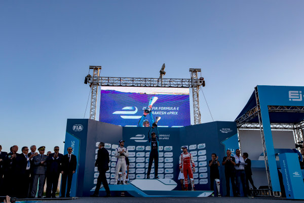 2016/2017 FIA Formula E Championship. Marrakesh ePrix, Circuit International Automobile Moulay El Hassan, Marrakesh, Morocco. Saturday 12 November 2016. Sam Bird (GBR), DS Virgin Racing, Spark-Citroen, Virgin DSV-02, Sebastien Buemi (SUI), Renault e.Dams, Spark-Renault, Renault Z.E 16 and Felix Rosenqvist (SWE), Mahindra Racing, Spark-Mahindra, Mahindra M3ELECTRO on the podium. Photo: Zak Mauger/Jaguar Racing ref: Digital Image _X0W6641