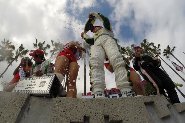 11-13 April, 2014, Long Beach, California USA Mike Conway, Will Power and Carlos Munoz in victory lane spraying champagne ©2014, Lesley Ann Miller LAT Photo USA