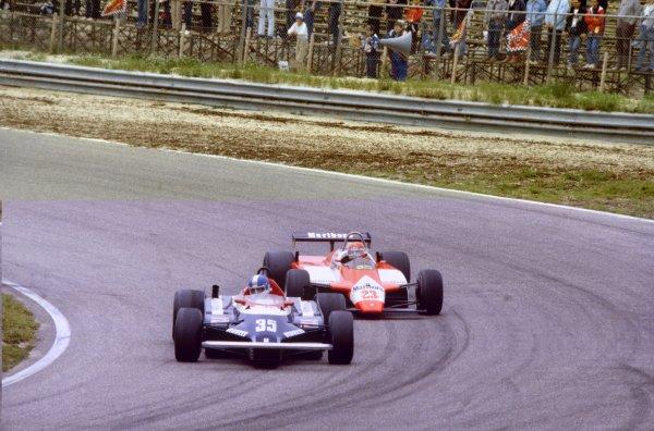 1982 Dutch Grand Prix.Zandvoort, Holland. 3 July 1982.Derek Warwick, Toleman TG181C-Hart, retired, leads Bruno Giacomelli, Alfa Romeo 182, 11th position, action.World Copyright: LAT PhotographicRef: 35mm transparency 82HOL86
