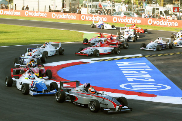 Luciano Bacheta (GBR) leads at the start of the race.