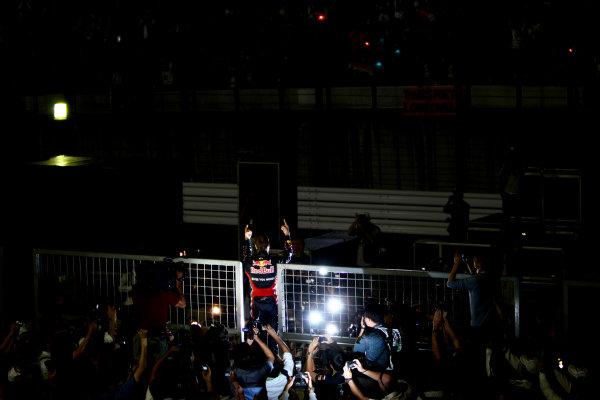Suzuka Circuit, Suzuka, Japan.9th October 2011.Sebastian Vettel, Red Bull Racing RB7 Renault, 3rd position, celebrates his second world championship with his team. Portrait. Atmosphere. World Copyright: Andy Hone/LAT Photographicref: Digital Image CSP26107