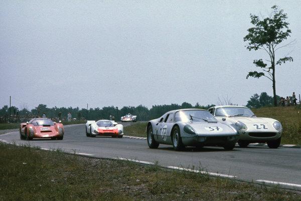 Watkins Glen, New York, USA. 14th July 1968. Rd 8.Dieter Oest/Nicholas Davidson (Porsche 904 GTS), retired, leads Bob Grossman/Ronnie Bucknum (Ferrari 275 GTB/4), 9th position, with just behind, Werner Frank/Ralph Trieschmann (Porsche 906 E), 4th position and Hans Herrmann/Tetsu Ikuzawa/Jo Siffert (Porsche 908), 6th position, action. World Copyright: LAT Photographic.Ref:  68WG6HR06.