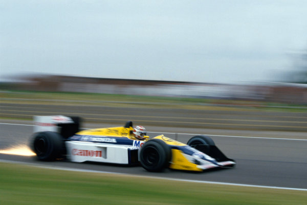 Silverstone, England.10-12 July 1987.Nelson Piquet (Williams FW11B Honda) 2nd position, action.World Copyright - LAT Photographic.Ref: 87 GB 06