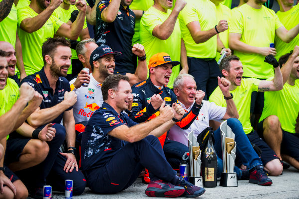 Sepang International Circuit, Sepang, Malaysia. Sunday 1 October 2017. Daniel Ricciardo, Red Bull Racing, 3rd Position, Helmut Markko, Consultant, Red Bull Racing, Max Verstappen, Red Bull, 1st Position, Christian Horner, Team Principal, Red Bull Racing, and the Red Bull Racing team celebrate. World Copyright: Glenn Dunbar/LAT Images  ref: Digital Image _X0W9272