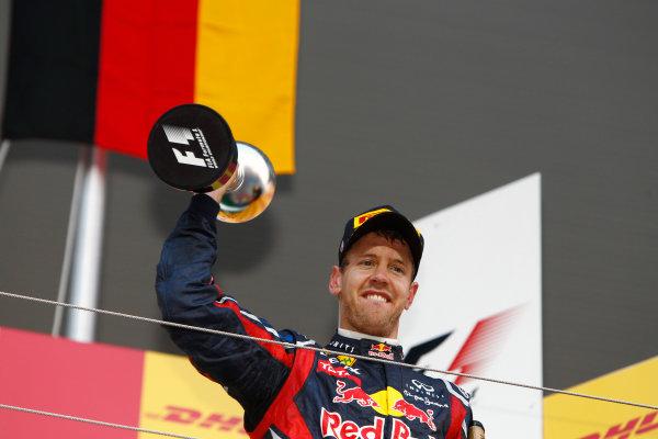 Suzuka Circuit, Suzuka, Japan.9th October 2011.Sebastian Vettel, Red Bull Racing RB7 Renault, 3rd position, lifts the trophy. Portrait. Podium. World Copyright:Glenn Dunbar/LAT Photographicref: Digital Image _G7C2518