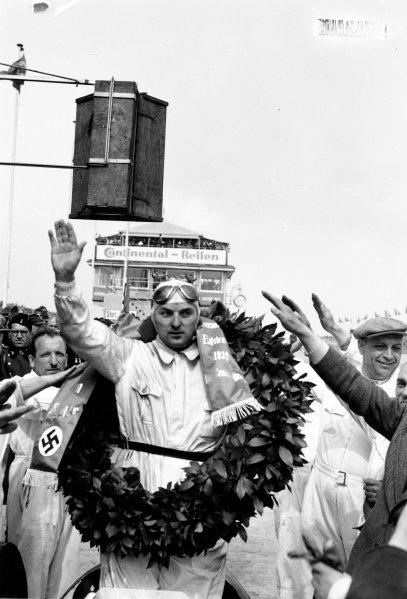 Nurburgring, Germany. 21 May 1939.Hermann Lang (Mercedes-Benz W154), 1st position, podium, portrait. World Copyright: Robert Fellowes/LAT PhotographicRef: 39EIFRF