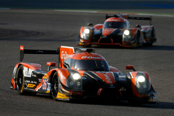 2015 FIA World Endurance Championship Bahrain 6-Hours Bahrain International Circuit, Bahrain Saturday 21 November 2015. Roman Rusinov, Julien Canal, Sam Bird (#26 LMP2 G-Drive Racing Ligier JS P2 Nissan) leads Gustavo Yacaman, Luis Felipe Derani, Ricardo Gonzalez (#28 LMP2 G-Drive Racing Ligier JS P2 Nissan). World Copyright: Alastair Staley/LAT Photographic ref: Digital Image _79P0184
