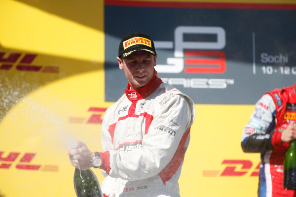 2014 GP3 Series. Round 8.   Sochi Autodrom, Sochi, Russia. Sunday Race 2 Sunday 12 October 2014. Dean Stoneman (GBR, Marussia Manor Racing) sprays the champagne on the podium. Photo: Glenn Dunbar/GP3 Series Media Service. ref: Digital Image _89P3038