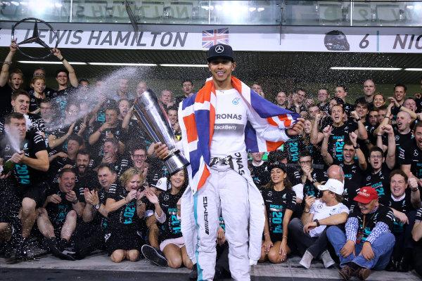 Yas Marina Circuit, Abu Dhabi, United Arab Emirates. Sunday 23 November 2014.  Lewis Hamilton and the Mercedes team celebrate championship victory.  World Copyright: Steve Etherington/LAT Photographic. ref: Digital Image SNE22518