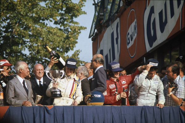 1974 Italian Grand Prix.  Monza, Italy. 6-8th September 1974.  Ronnie Peterson, Lotus, 1st position, Emerson Fittipaldi, McLaren, 2nd position and Jody Scheckter, Tyrrell, 3rd position, on the podium.  Ref: 74ITA02. World Copyright: LAT Photographic