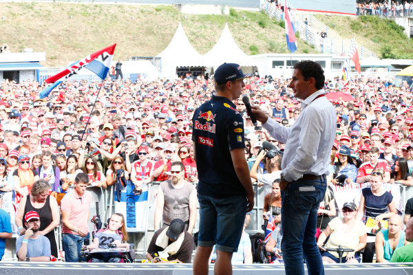 Hockenheim, Germany. Saturday 30 July 2016. Max Verstappen, Red Bull, is interviewed on stage at an event for fans. World Copyright: Andy Hone/LAT Photographic ref: Digital Image _ONY7727