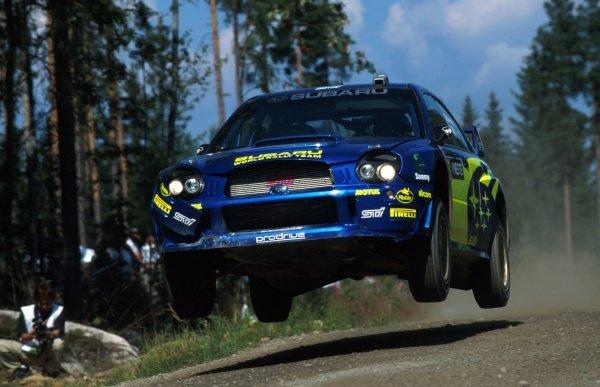 Petter Solberg (NOR) and Phil Mills Subaru Impreza WRC.FIA World Rally Championship, Rd9, Neste Rally Finland, Finland. 8-11 August 2002.BEST IMAGE