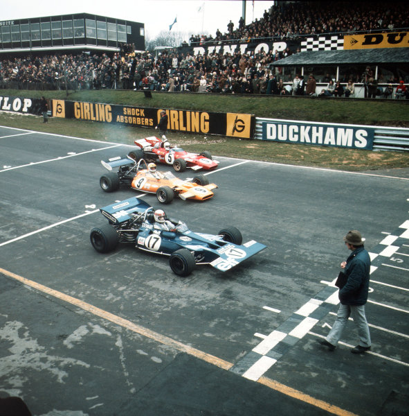 Brands Hatch, Great Britain.21 March 1971.Jackie Stewart (Tyrrell 001-Ford Cosworth), Denny Hulme (McLaren M19A-Ford Cosworth) and Clay Regazzoni (Ferrari 312B2) line up on the grid. Regazzoni finished in 1st position.Ref-3/4572D.World Copyright - LAT Photographic
