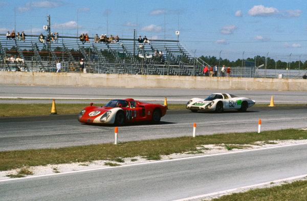Daytona, Florida, USA. 3rd - 4th February 1968.Udo Schutz/Nino Vaccarella (Alfa Romeo T33/2), 5th position, leadsJo Siffert/Hans Herrman/Gerhard Mitter (Porsche 907LH), 2nd position, action. World Copyright: LAT Photographic.Ref:  68S/CARS12