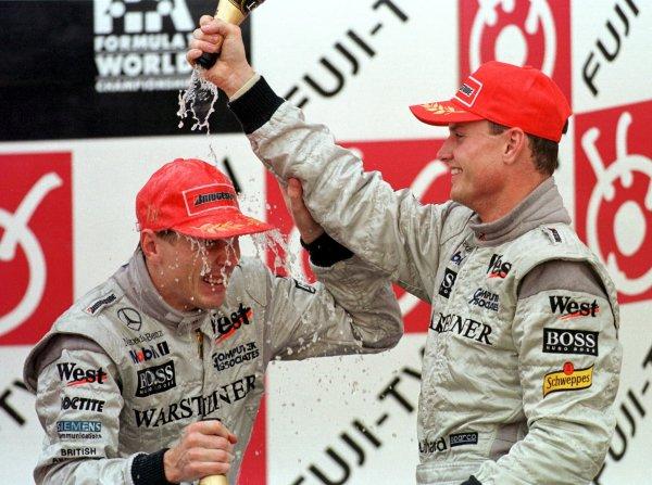 Japanese Grand Prix.Suzuka, Japan.30/10-1/11 1998.Mika Hakkinen celebrates clinching the World Championship with McLaren Mercedes-Benz team-mate David Coulthard.World Copyright - Steve Etherington/LAT Photographic