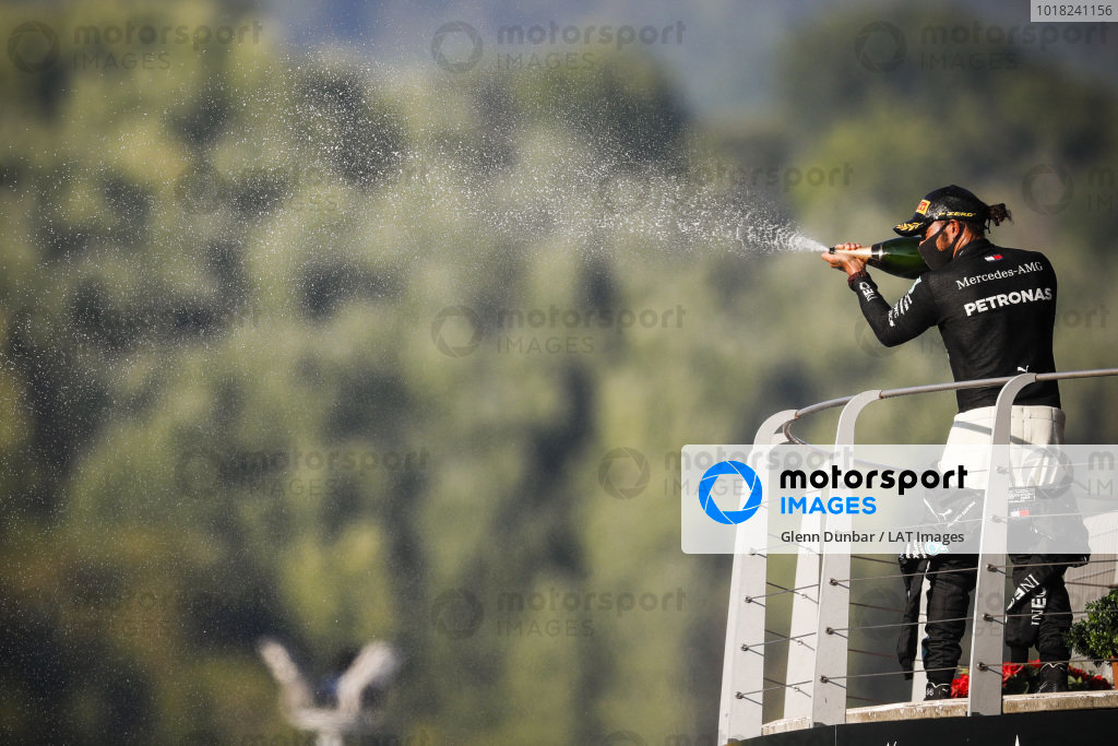 Lewis Hamilton, Mercedes-AMG Petronas F1, 1st position, sprays Champagne from the podium