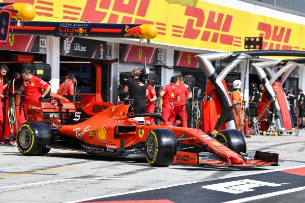 Sebastian Vettel, Ferrari SF90, leaves the garage