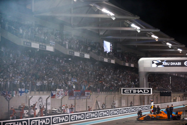 Fernando Alonso, McLaren MCL33, waves to fans after completing his final race in F1