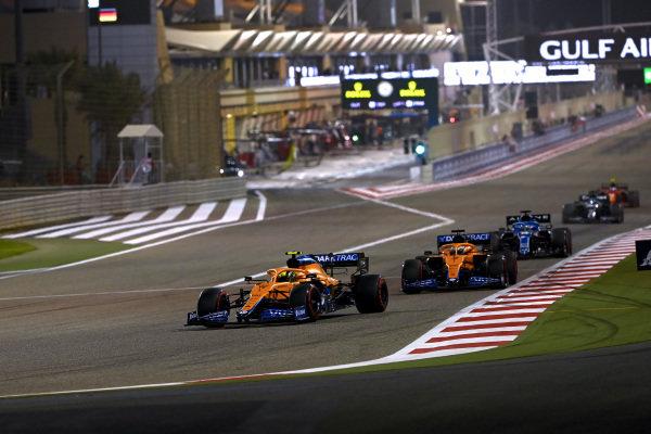 Lando Norris, McLaren MCL35M, leads Daniel Ricciardo, McLaren MCL35M, and Fernando Alonso, Alpine A521