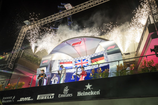 Fireworks at the podium as Lewis Hamilton, Mercedes AMG F1, Max Verstappen, Red Bull Racing, and Sebastian Vettel, Ferrari, celebrate with their champagne