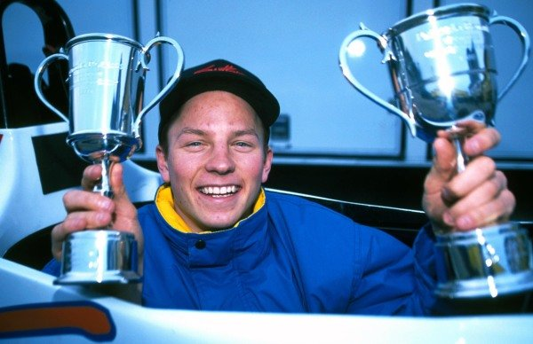 Kimi Raikkonen (FIN) Manor Motorsport shows off the trophies he received for winning all the races in the series. Formula Renault Winter Series, Donington Park, England, 21 November 1999.