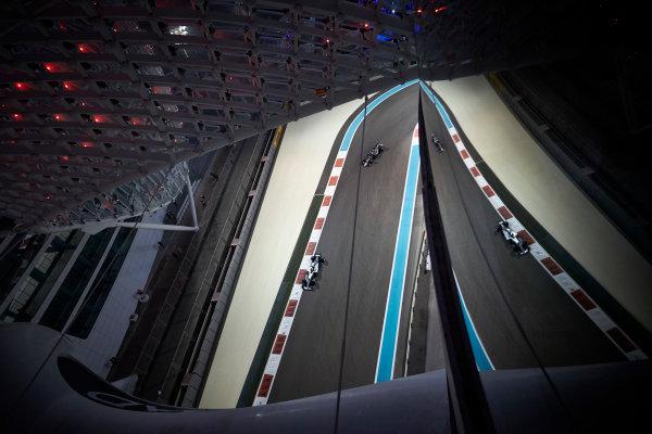 Yas Marina Circuit, Abu Dhabi, United Arab Emirates. Friday 24 November 2017. Lewis Hamilton, Mercedes F1 W08 EQ Power+, leads Kevin Magnussen, Haas VF-17 Ferrari. World Copyright: Steve Etherington/LAT Images  ref: Digital Image SNE20326