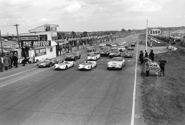 Snetterton, England. 28th September 1963.L to R: Roy Salvadori (Cooper Monaco T61 Climax), retired, Jim Clark (Lotus 23B Ford), 1st position, Tony Hegbourne (Loyus 23B Ford), retired and Jack Sears (Ferrari 250 GTO), 4th position, at the start of the race, action. World Copyright: LAT Photographic.Ref:  L63 - 327 - 11A.