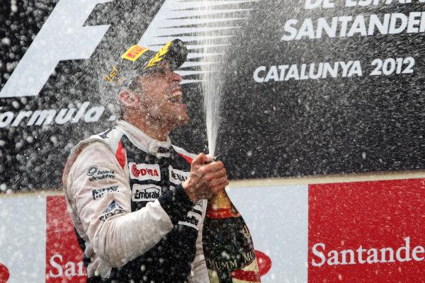 Circuit de Catalunya, Barcelona, Spain 13th May 2012 Pastor Maldonado, Williams F1 Team celebrates with champagne on the podium after winning the race World Copyright:Glenn Dunbar/LAT Photographic ref: Digital Image CG8C5625
