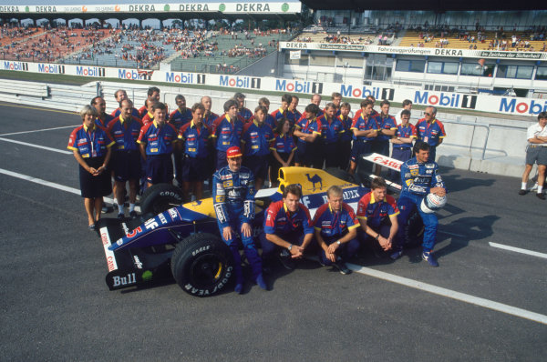 Hockenheim, Germany. 26 July 1992.Nigel Mansell and Riccardo Patrese (Williams FW14B-Renault), pose for a team shot in the pit lane, portrait.World Copyright: LAT PhotographicRef: 35mm transparency 92GER14