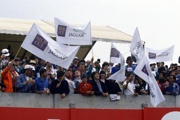 Le Mans, France. 11th - 12th June 1988 Jaguar fans wave flags in the stands, atmosphere. World Copyright: LAT Photographic ref: 88LM21