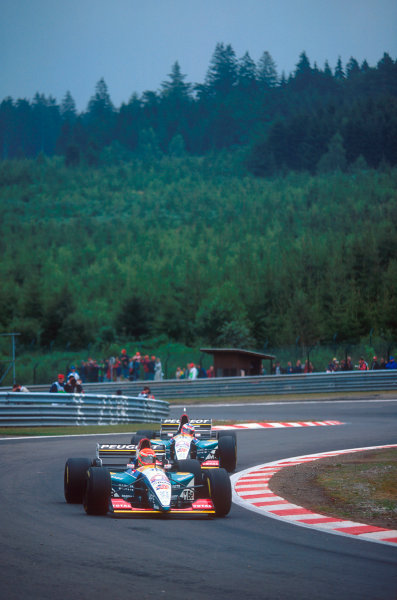 Spa-Francorchamps, Belgium.25-27 August 1995.Eddie Irvine followed by teammate Rubens Barrichello (both Jordan 195 Peugeot's). Barrichello finished 6th but Irvine exited the race after a refuelling pit fire. Ref-95 BEL 22.World Copyright - LAT Photographic