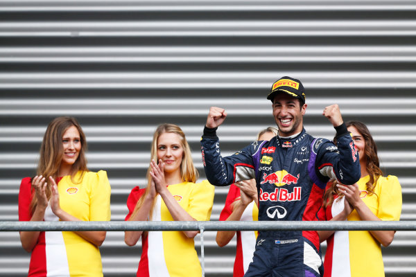 Spa-Francorchamps, Spa, Belgium. Sunday 24 August 2014. Daniel Ricciardo, Red Bull Racing, 1st Position, celebrates as he arrives on the podium. World Copyright: Sam Bloxham/LAT Photographic. ref: Digital Image _SBL8312