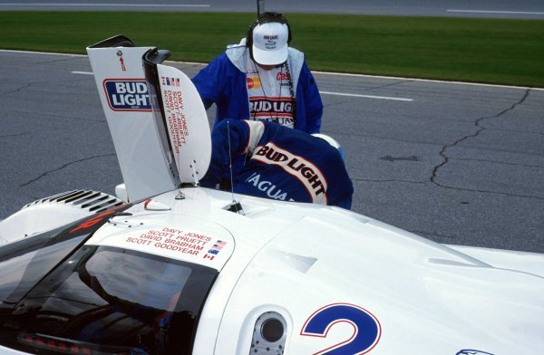 David Brabham (AUS) get out of the TWR Jaguar XJR-12D during a pit stop.