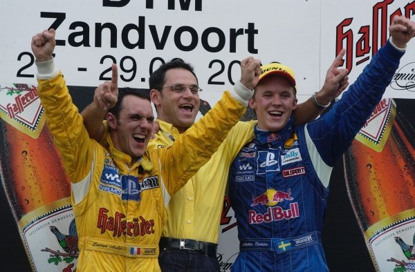 Double success for the Abt-Team with a win for Mattias Ekstrom (SWE), right, and the 2002 championship won by Laurent Aiello (FRA), left. Team Abt Sportsline team manager Hans-Jurgen Abt (GER).DTM Championship, Rd9, Zandvoort, Holland. 29 September 2002.DIGITAL IMAGE