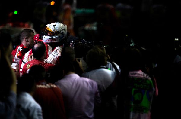 Marina Bay Circuit, Singapore. Sunday 20 September 2015. Sebastian Vettel, Ferrari, 1st Position, celebrates on arrival in Parc Ferme with his team. World Copyright: Glenn Dunbar/LAT Photographic ref: Digital Image _W2Q5452