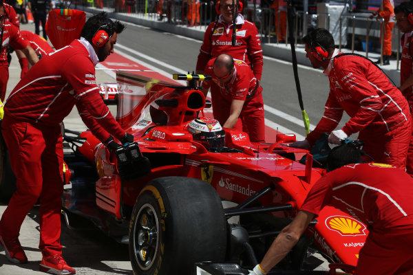 Sochi Autodrom, Sochi, Russia. Friday 28 April 2017. Kimi Raikkonen, Ferrari, is wheeled back by team members in the pit lane. World Copyright: LAT Images ref: Digital Image DJ5R2961