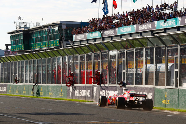 Albert Park, Melbourne, Australia. Sunday 26 March 2017. Sebastian Vettel, Ferrari SF70H, takes the applause of his team on the pit wall, as he celebrates winning the Australian Grand Prix. World Copyright: Sam Bloxham/LAT Images ref: Digital Image _W6I4899