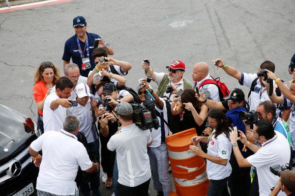 Interlagos, Sao Paulo, Brazil. Sunday 9 November 2014. Felipe Massa, Williams F1, poses for photos with fans. World Copyright: Charles Coates/LAT Photographic. ref: Digital Image _J5R5252