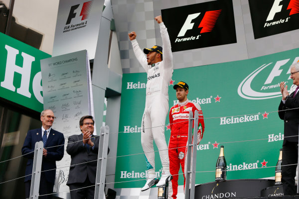Circuit Gilles Villeneuve, Montreal, Canada. Sunday 12 June 2016. Lewis Hamilton, Mercedes AMG, 1st Position, jumps in celebration on the podium. World Copyright: Andy Hone/LAT Photographic ref: Digital Image _ONY9066