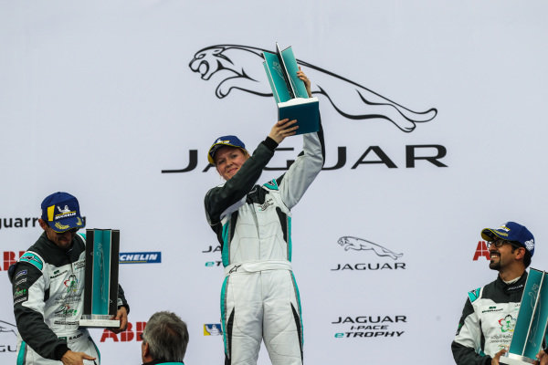 AM class victor Alice Powell (GBR), Jaguar VIP car holds her trophy aloft on the podium