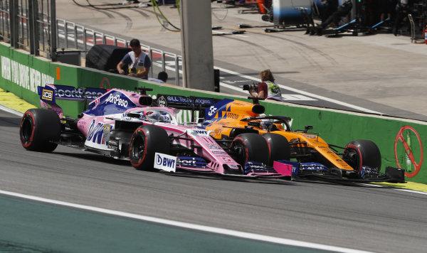 Sergio Perez, Racing Point RP19, battles with Carlos Sainz Jr., McLaren MCL34