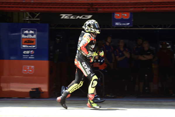 Andrea Iannone, Aprilia Racing Team Gresini, running in pit lane.