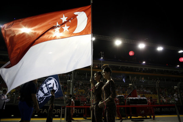 National Anthem is observed with Flag of Singapore on the grid at Formula One World Championship, Rd14, Singapore Grand Prix, Race, Marina Bay Street Circuit, Singapore, Sunday 17 September 2017. BEST IMAGE