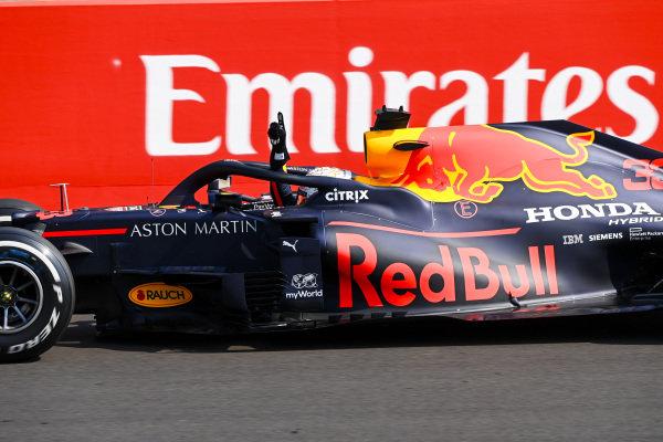 Race Winner Max Verstappen, Red Bull Racing RB16 crosses the finish line
