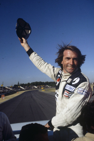 Jacques Laffite on the parade lap after his victory.