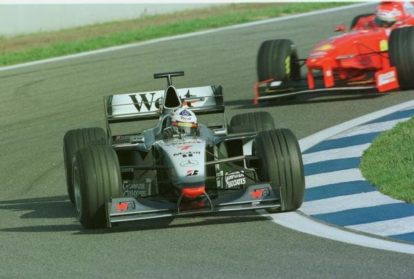 1998 Spanish Grand Prix.Catalunya, Barcelona, Spain.8-10 May 1998.David Coulthard (McLaren MP4/13 Mercedes-Benz) leads Eddie Irvine (Ferrari F300) during qualifying.World Copyright - Steve Etherington/LAT Photographic
