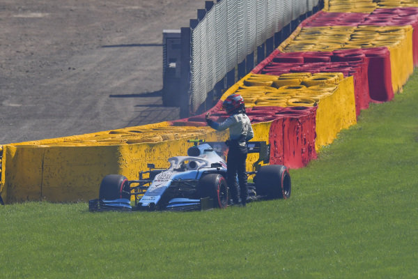 Robert Kubica, Williams Racing, stops in qualifying with a smoking and flaming engine