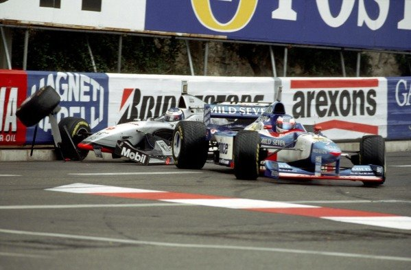 Mika Häkkinen, McLaren MP4-12 Mercedes, crashes into Jean Alesi, Benetton B197 Renault.