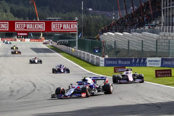 Pierre Gasly, Toro Rosso STR14, leads Lance Stroll, Racing Point RP19 and Daniil Kvyat, Toro Rosso STR14