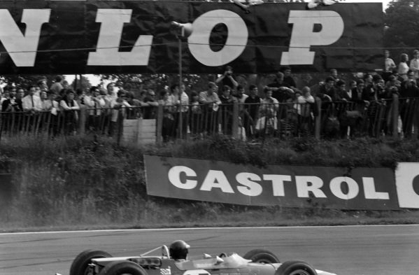 Crowd watch as Jackie Oliver, Lotus 48 Ford, recovers from a spin.